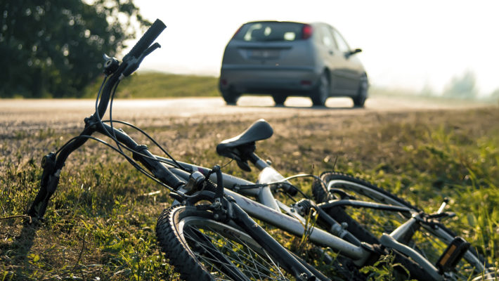 Car and bicycle accident, outdoor shot with blurred background