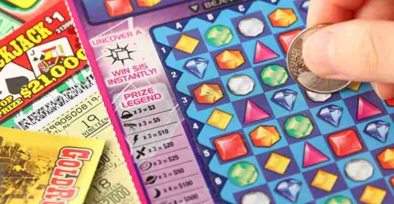 Coquitlam BC Canada – May 25, 2014 : Scratching lottery tickets.