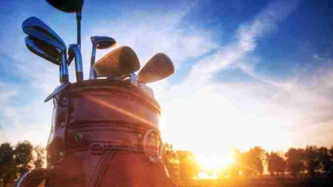 Professional golf gear on the golf course at sunset.