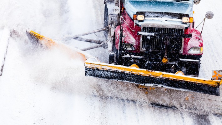 bigstock Snowplow Removing The Snow Fro 618805851