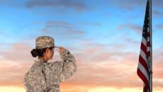 Closeup of an American Female Soldier in combat uniform saluting