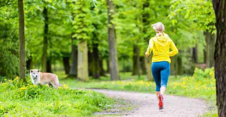 Woman Running In Summer Park