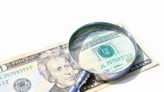 Money Under Magnify Glass Isolated Over White