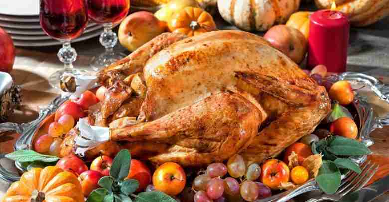 Thanksgiving dinner. Roasted turkey on holiday table with pumpki