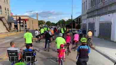 Photo of 'Ride of Silence' for fallen Charles City cyclist touts 90+ riders, many more attendees; memorial service to be held Saturday